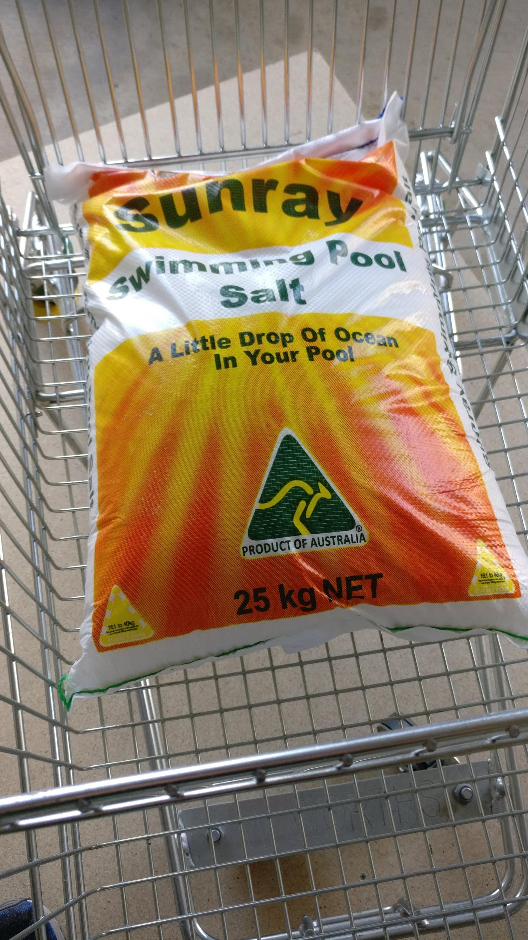 Bag of 25kg pool salt in shopping trolley